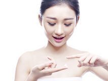 Young asian woman applying cream Stock Photos