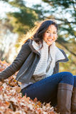 Young Asian woman in autumn portrait Royalty Free Stock Image