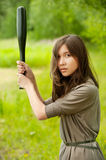 Young asian woman with bat Royalty Free Stock Images