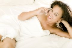Young asian woman in bed Royalty Free Stock Photo