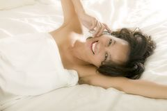 Young asian woman in bed royalty free stock photography