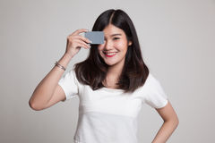 Young Asian woman with  blank card over her eye. Stock Images