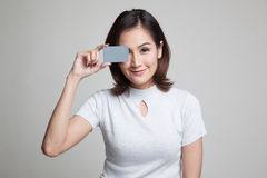 Young Asian woman with  blank card over her eye. Royalty Free Stock Photos