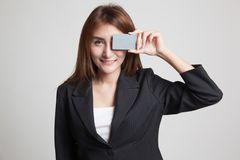 Young Asian woman with  blank card over her eye. Stock Photography