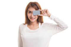 Young Asian woman with  blank card over her eye. Royalty Free Stock Images