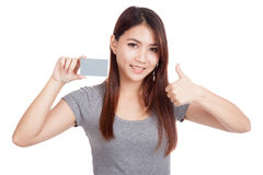 Young Asian woman with blank card show thumbs up Stock Photo