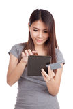 Young Asian woman with blank card and tablet PC Royalty Free Stock Image