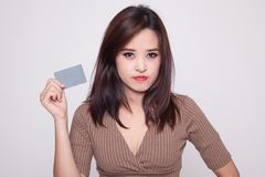Young Asian woman with a blank card. stock image