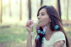 Young asian woman blowing bubble in the park Stock Photography