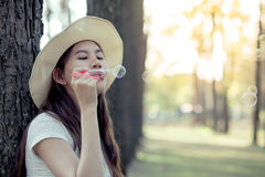 Young asian woman blowing bubble in the park Stock Photos