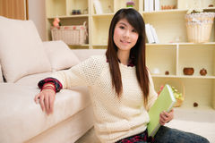 Young asian woman with book Stock Photography