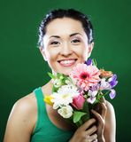 Young asian woman with bouquet flowers Royalty Free Stock Photo