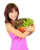 Young asian woman with a box of donut and a bowl of veg Stock Photo