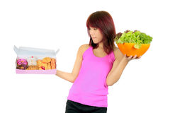 Young asian woman with a box of donut and a bowl of veg Royalty Free Stock Photography