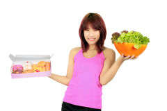 Young asian woman with a box of donut and a bowl of veg Royalty Free Stock Photos