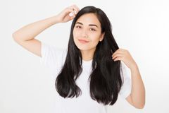 Young asian woman with brunette healthy clean shiny hair isolated on white background. Girl long hairstyle. Copy space