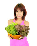 Young asian woman with ca bowl of various vegetables Stock Photo