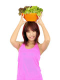 Young asian woman with ca bowl of various vetgetables Stock Photography