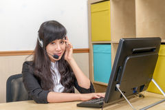 Young Asian Woman at Call Center looking annoyed Royalty Free Stock Photography
