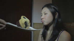 Young asian woman can not resists to sweet cake stock video