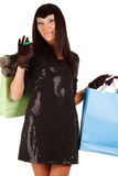 Young asian woman carrying shopping bag. Isolated on white Stock Image