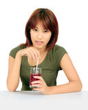Young asian woman with a cglass of grape juice Stock Image