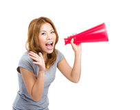 Young asian woman cheering using megaphone Royalty Free Stock Photos