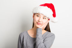 Young asian woman with Christmas hat isolated on white. Royalty Free Stock Images