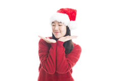 Young asian woman with Christmas hat isolated on white. royalty free stock photo