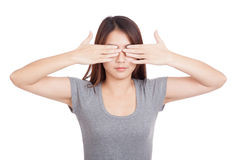Young Asian woman close  eyes with both hands Royalty Free Stock Photos