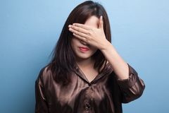 Young Asian woman close her eyes with hand. Royalty Free Stock Photos