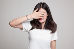 Young Asian woman close her eyes with hand. Royalty Free Stock Photo