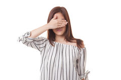 Young Asian woman close her eyes with hand. Royalty Free Stock Images