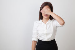 Young Asian woman close her eyes with hand. Stock Image