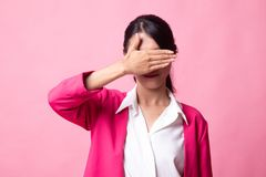 Young Asian woman close her eyes with hand royalty free stock photo