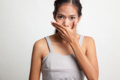 Young Asian woman close her mouth with hand. Stock Image