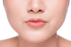 Young asian woman close up. Perfect natural lip makeup Stock Photos
