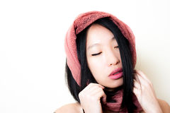 Young asian woman close up posing closing eyes Royalty Free Stock Photo