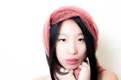 Young asian woman close up posing looking at camera Royalty Free Stock Photo