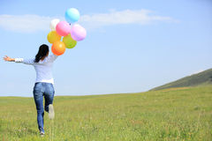 Young asian woman with colored balloons Royalty Free Stock Photography