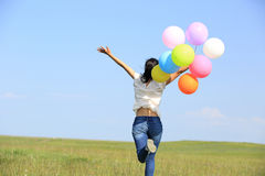 Young asian woman with colored balloons royalty free stock images