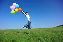 Young asian woman with colored balloons Stock Image
