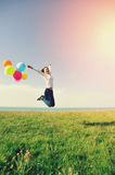 Young asian woman with colored balloons Stock Photos