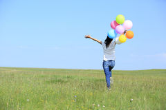 Young asian woman with colored balloons Royalty Free Stock Image