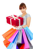 Young Asian woman with colorful shopping bags Stock Photos