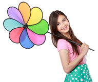 Young asian woman with colorful windmill Stock Photography