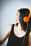 Young Asian woman concentrating on her music Stock Image