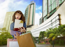Young asian woman confused because his shopping bag Royalty Free Stock Photo