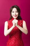 Young asian woman with congratulation gesture Royalty Free Stock Photos