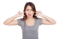 Young Asian woman covering her ears. Isolated on white background Stock Image